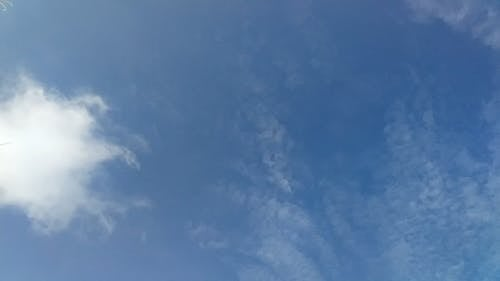 Low Angle View of White Clouds and Blue Sky