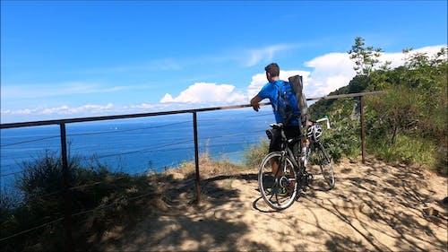 A Mountain Biker Enjoying The Ocean's View
