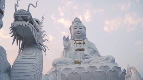 Beautiful Big White Guan Yin Statue and White Dragon