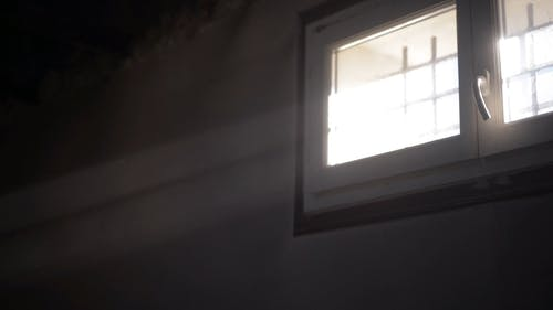 Sunrays Coming from a Glass Window
