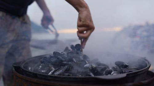 Cooking Shellfish Mussel Outdoors In Big Iron Ketle