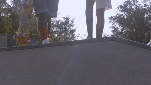 Two Young Skateboarders Ready with their Boards