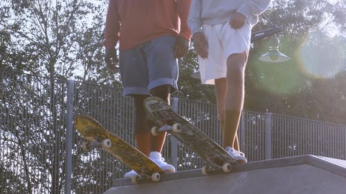 Guys with their Skateboards ready to Slide