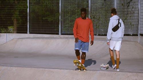 Two Skateboarders Sliding