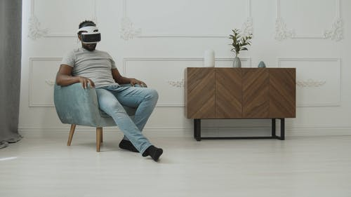 Guy with his VR Headset Looking Around at his Room