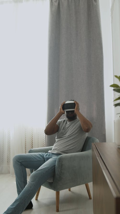 Man Sitting while Using the VR Headset