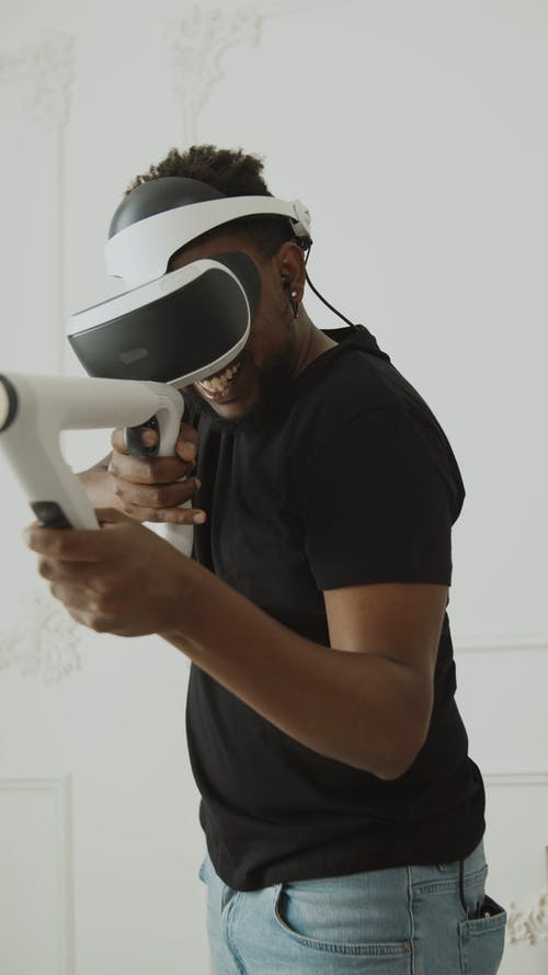 Young Guy with VR Glasses Playing Game