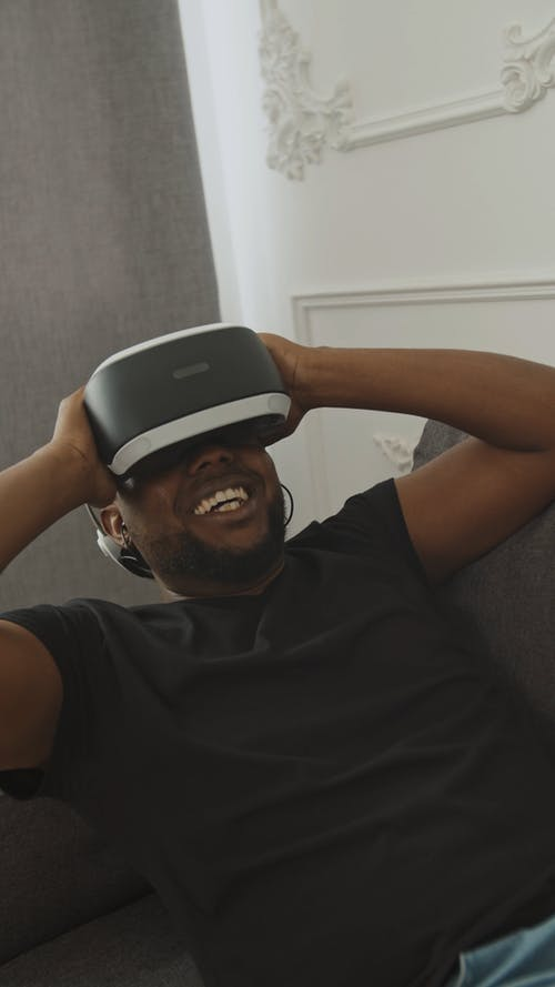 Guy Experiencing Virtual Reality using his VR Headset