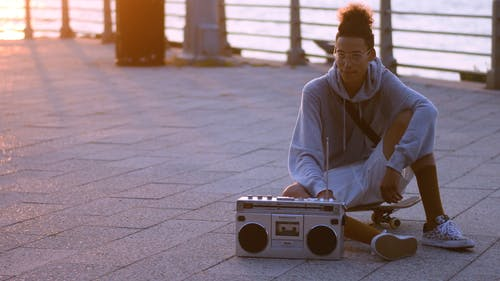 Skateboarder with his Boombox Greeting his Friend