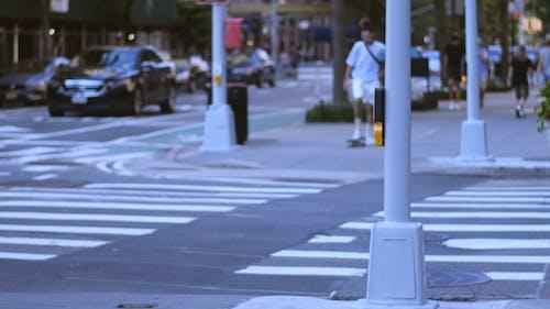 Crossing A Street Riding On A Skateboard