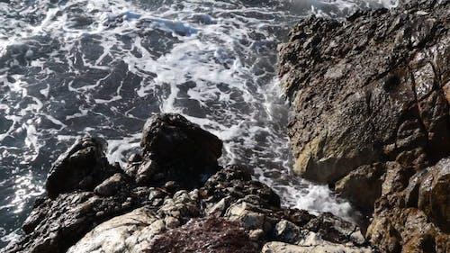 Sea Waves Crashing on Rocky Shore
