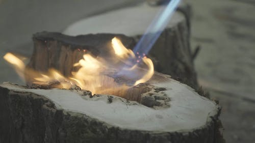 Person Burning a Wood