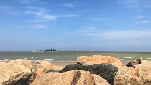 Rocky Shore Under Blue Sky