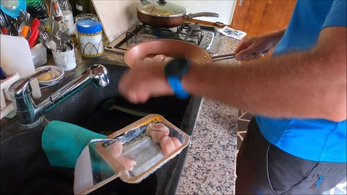 Man Cooking While Doing a Food Vlog