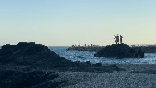 Boys Jumping in the Sea from a Rock