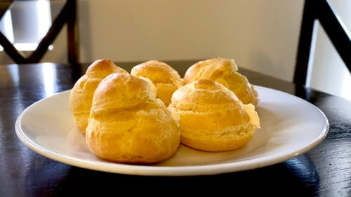 Mouthwatering Cream Puffs on a Plate