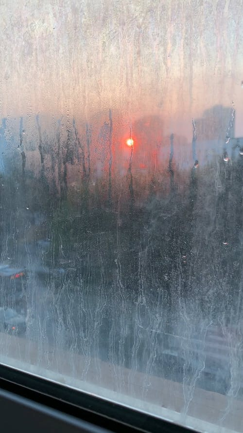 Sunset View from a Frosted Window Glass