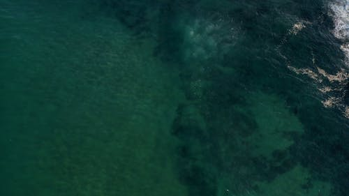 Drone Footage of a Beach Under Blue Sky