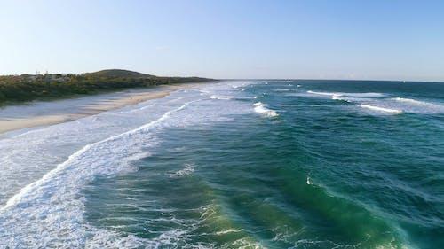 Waves Kissing The Beach Shoreline