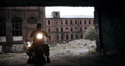 Bikers Leaving An Abandoned Property