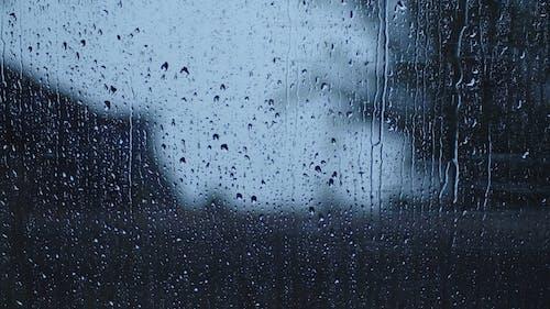 Rain Water Sliding Down The Glass Window Surface