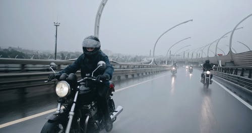 Big Bike Riders Driving On Wet Roads