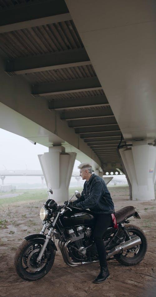 Bikers Resting Under A Bridge