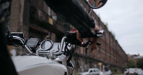 A Biker Hands On The Steering Wheel