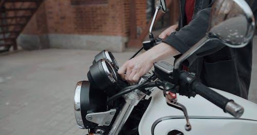 A Biker Checking His Bike Condition