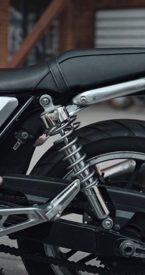 Man Adjusting Bolt of his Motorcycle