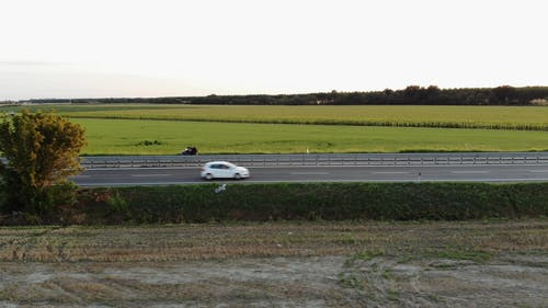 A Highway Built Crossing An Agricultural Land