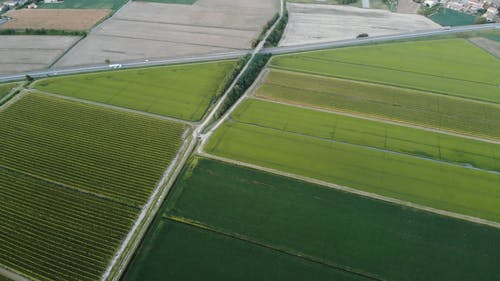 A Highway Built Across An Agricultural Area In THe Countryside