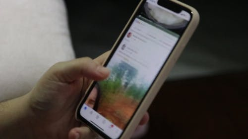 Close-Up View of Person Surfing Online Using a Smartphone