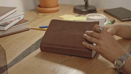 Man Opening Holy Bible and Reading it