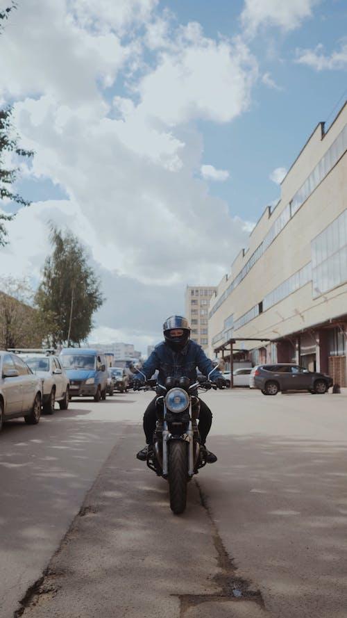 Man in Blue Denim Jacket Riding His Motorcycle