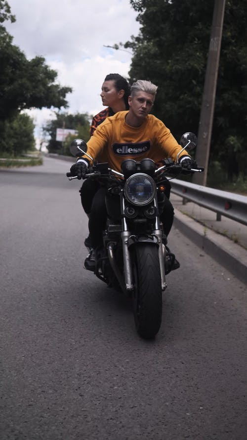 Two People Riding A Motorcycle