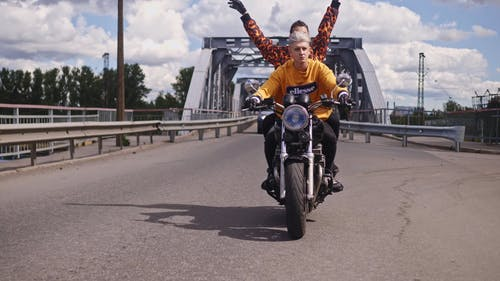 A Couple Riding A Motorbike