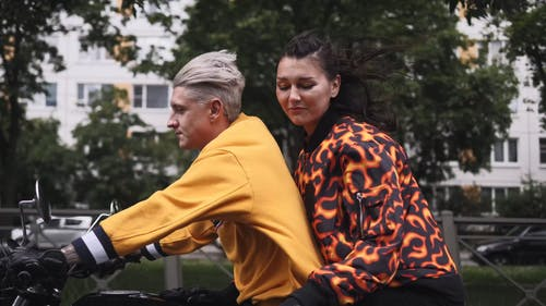 A Couple On A Road trip Riding A Motorcycle