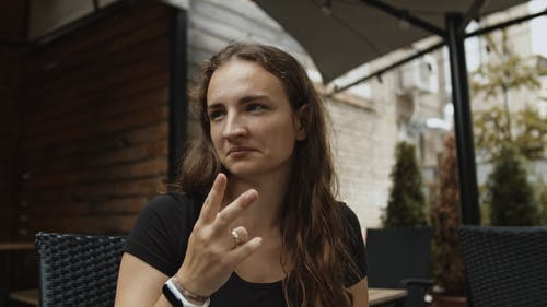 Woman Having Conversation by Doing Sign Language