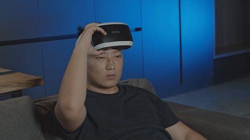 A Man Using Virtual Reality Glasses