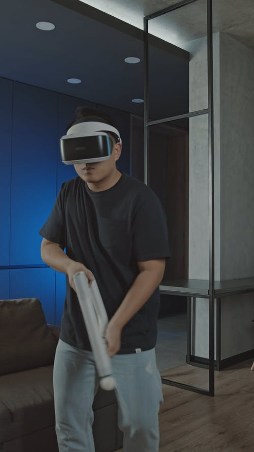 A Man Playing A Virtual Reality Game