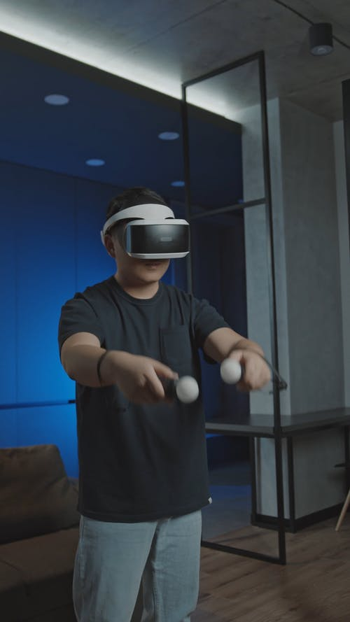 A Man With A Controller Playing A Virtual Reality Game