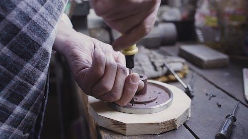 Carpenter Tightening Screw to a Wooden Piece