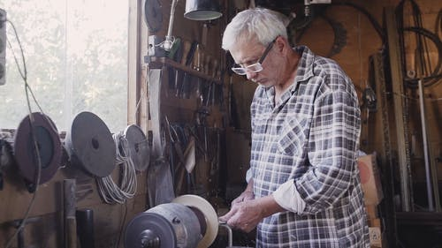 An Experienced Carpenter Shaping a Piece of Wood