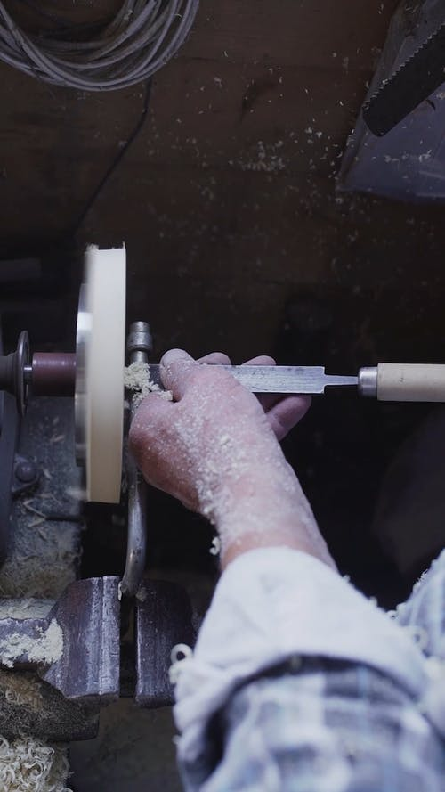 Carpenter Crafting a Circular Wooden Piece