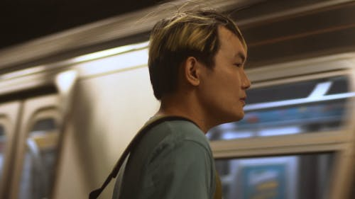 Man Standing In front of a Moving Metro Train