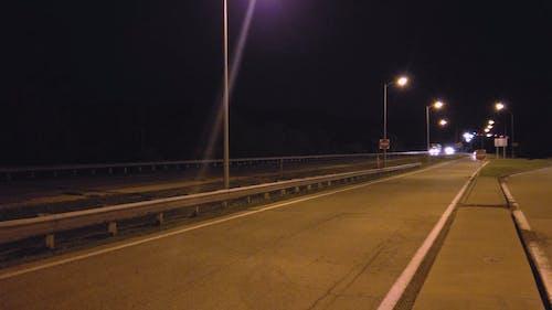 Vehicles on Expressway at Night