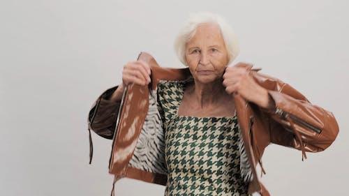 Elderly Woman Wearing Brown Jacket