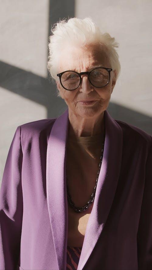 Elderly Woman in Purple Coat Smiling