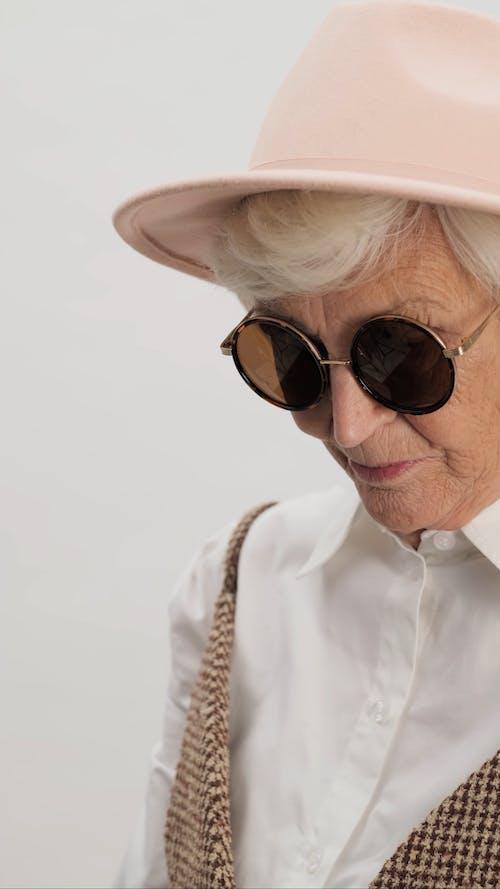 Stylish Mature Woman Wearing Hat and Sunglasses